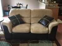 We are selling our beige microfiber and black leather