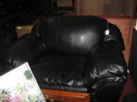 This club chair is black leather in good condition and