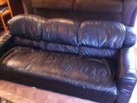 We have a like new black leather couch for sale. - No