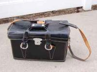 Very versatile black leather camera bag/carrying case.