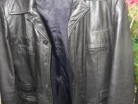 Stunning high quality black leather coat. Size guys's