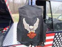 For sale is one Black Leather motorcycle vest for