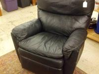 For sale we have a black leather recliner chair. It is