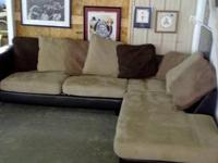 Available for sale is a black natural leather sectional