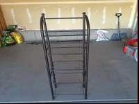 Black metal book/DVD shelf. Its in great condition.