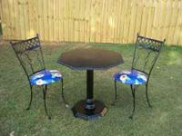 Black Metal Table and 2 vinyl upholstered chairs in