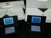 selling my kids black dsi . comes with box, charger,