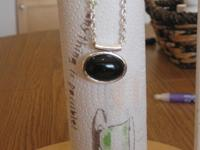 This Pendant Necklace has a Natural stone Black Onyx