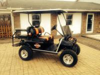 Beautiful raised club vehicle with black and orange