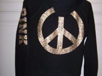 "Black ""pink"" jacket with hood and gold lettering. 21"