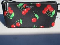 "Black purse with cherries, 10"" by 4 3/4"", with strap 14"