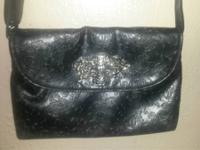 Hei y' all. I have a lovely black faux leather Rock
