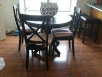 Black round pedestal table with 4 chairs for sale. We
