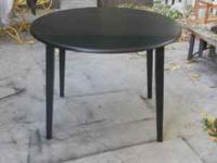 I have a nice black round table 39Wx29T. Sides do fold