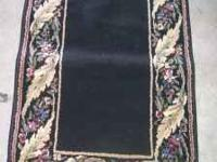 Really nice 2 x 3 black and beige rug perfect for hall,