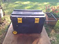 I have a black tool box with wheels and a handle