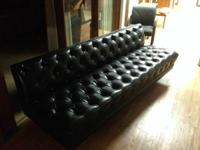 I have a 7 foot vintage vinyl black tufted sofa that