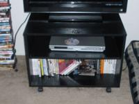 "Smaller black TV stand. Great for a 32"" or smaller flat"