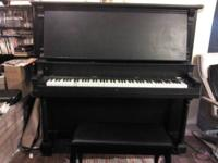 This is a heavy but beautiful piano.  It is black with