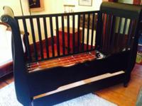 Extremely good black wood toddler bed with built in