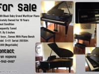 For Sale By Owner. Black Wurlitzer Baby Grand Piano In
