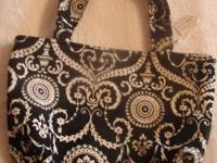 This is a pretty black and white  paisley tote. It is
