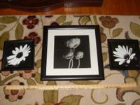 Black and white floral art.  The large picture is about