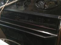 Black gas range in good condition for 150 obo electric