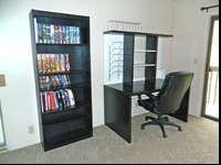 Black office furniture set for sale. Includes desk,