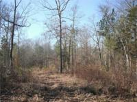 This tract is loaded with mature hardwood and bordered