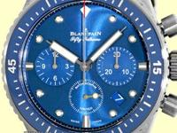 blue dial with luminescent hands and hour markers,