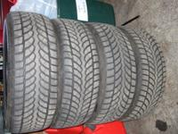 A set of 4 blizak snow and mud tires with les than 1000