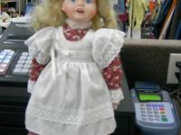 Blond doll with cute pinafore  Monday, Tuesday,