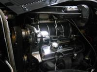 "Blower with two fours, four small block chevy new""."