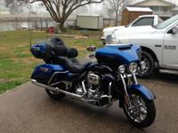 I have a blue 2014 Ultra classic CVO, with custom paint