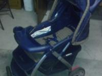 CLEAN BROWN AND BLUE EDDIE BOWER STROLLER AND EDDIE