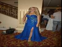 Beautiful blue dress with flattering strap; slit with