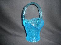 BLUE GLASS BASKET WITH CLEAR GLASS HANDLE IT MAYBE A