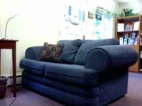 Blue Loveseat. Gently used, like-new condition. Solid