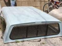 Truck bed topper (also known as camper shell or