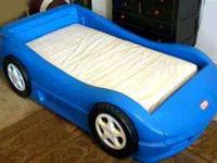 Blue Little Tikes Race Car Toddler Bed. This bed is