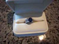 4 carat Blue Sapphire ring with approximately 1/3 carat