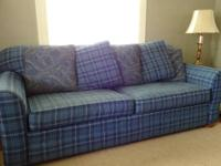 For sale is a complete size blue, plaid sofa in