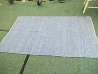 Here is a nice firmly knit blue location throw rug.