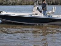 She is 24.5 feet overall and powered by the Suzuki