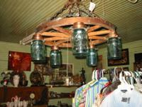 A Lovely Blue Mason Jar Wagon Wheel Chandelier. The