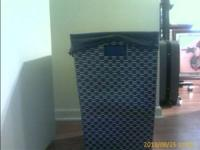 Up for consideration:  Blue Woven Strap Laundry Hamper,