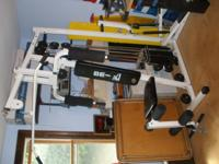 Home gym with pull down, leg lift, curl, stepper, etc.