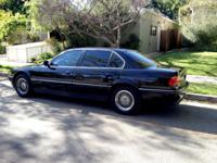 This is a mint condition BMW 1998 740IL with 64,928