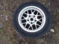 BMW rim with tire. From a 535I BMW if interestted call